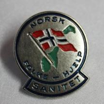 Norsk Folkehjelp sanitet nål 50 - 60 tallet (gitt av Arild Engen)