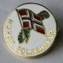 Norsk Folkehjelp merker tidlig logo