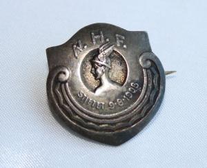 Norges Handels funktionæreres forbund 1921-1925 (Tidlig logo for Handel og Kontor)