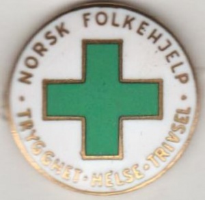 Norsk Folkehjelp nål ( ligger i samlingen til Aksel Rigmund Hjelland)