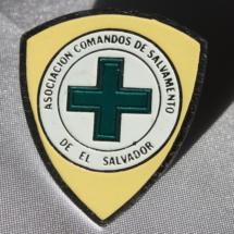 Comandos de Salvamento merke ( Norsk Folkehjelps søsterorganisasjon i El Salvador)