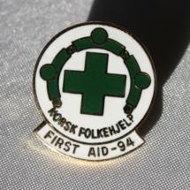 Norsk Folkehjelp merke som ble laget til OL i 1994