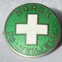 Norsk Folkehjelp nål fra 1939 - logoen er den første som ble benyttet. Merke tilhører John Åge Amundsen