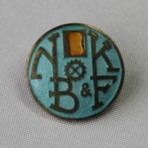 Norsk Bokbinder- og Kartonasjearbeiderforbund nål - stiftet i 1898 gikk inn i Norsk Grafisk Forbund i 1966 (Gullskrift med blå bakgrunn)