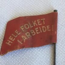 1 mai merke 1934 bakside. Merke ligger i samlingen til M. Østby