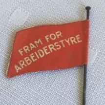 1 mai merke 1935 bakside. Merke ligger i samlingen til M. Østby