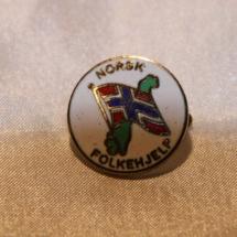 Norsk Folkehjelp merke tidlig logo 60 - 70 tallet, versjon 2